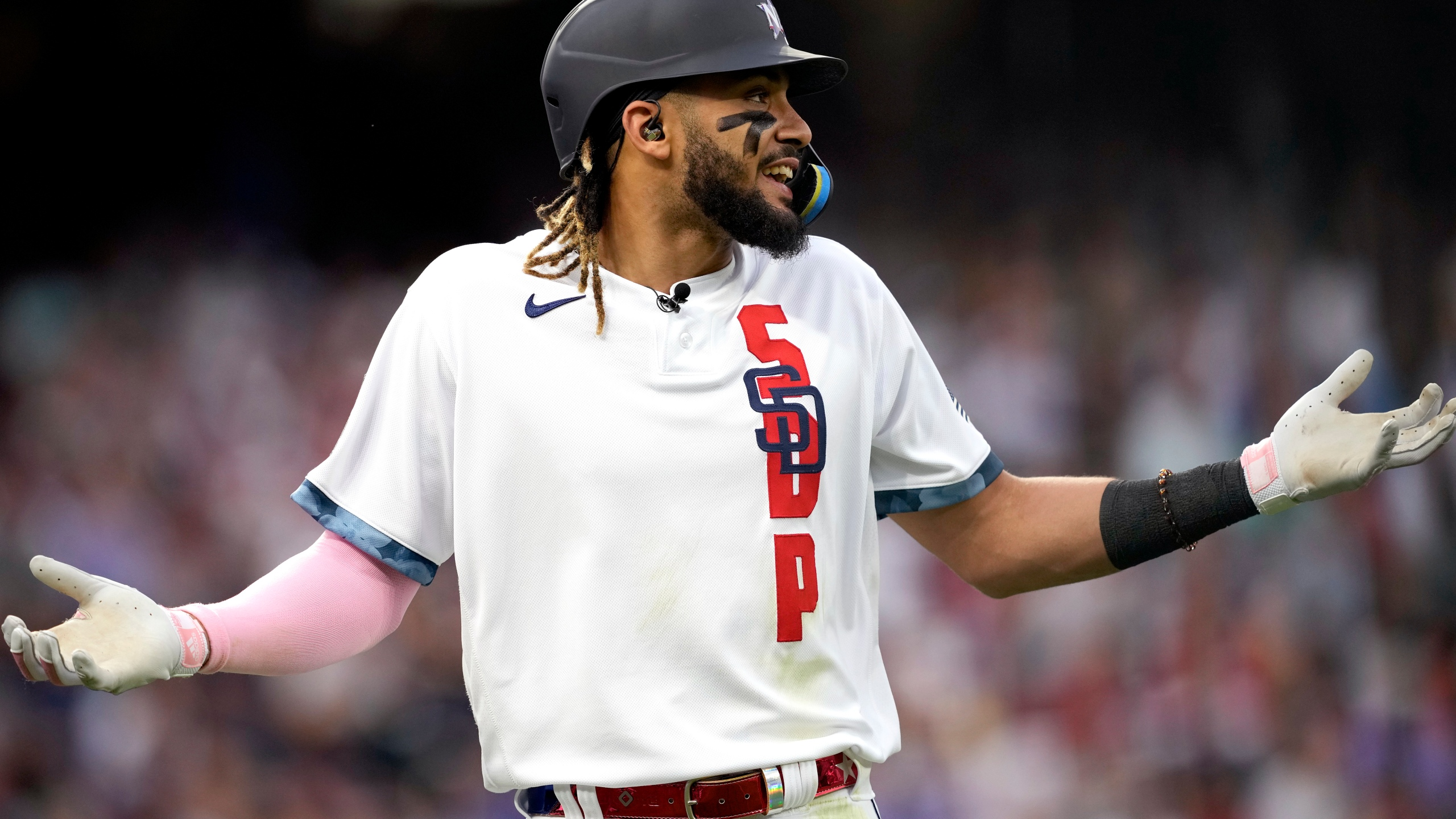 National League's Fernando Tatis Jr., of the San Diego Padres, reacts after flying out during the third inning of the MLB All-Star baseball game, Tuesday, July 13, 2021, in Denver. (AP Photo/David Zalubowski)