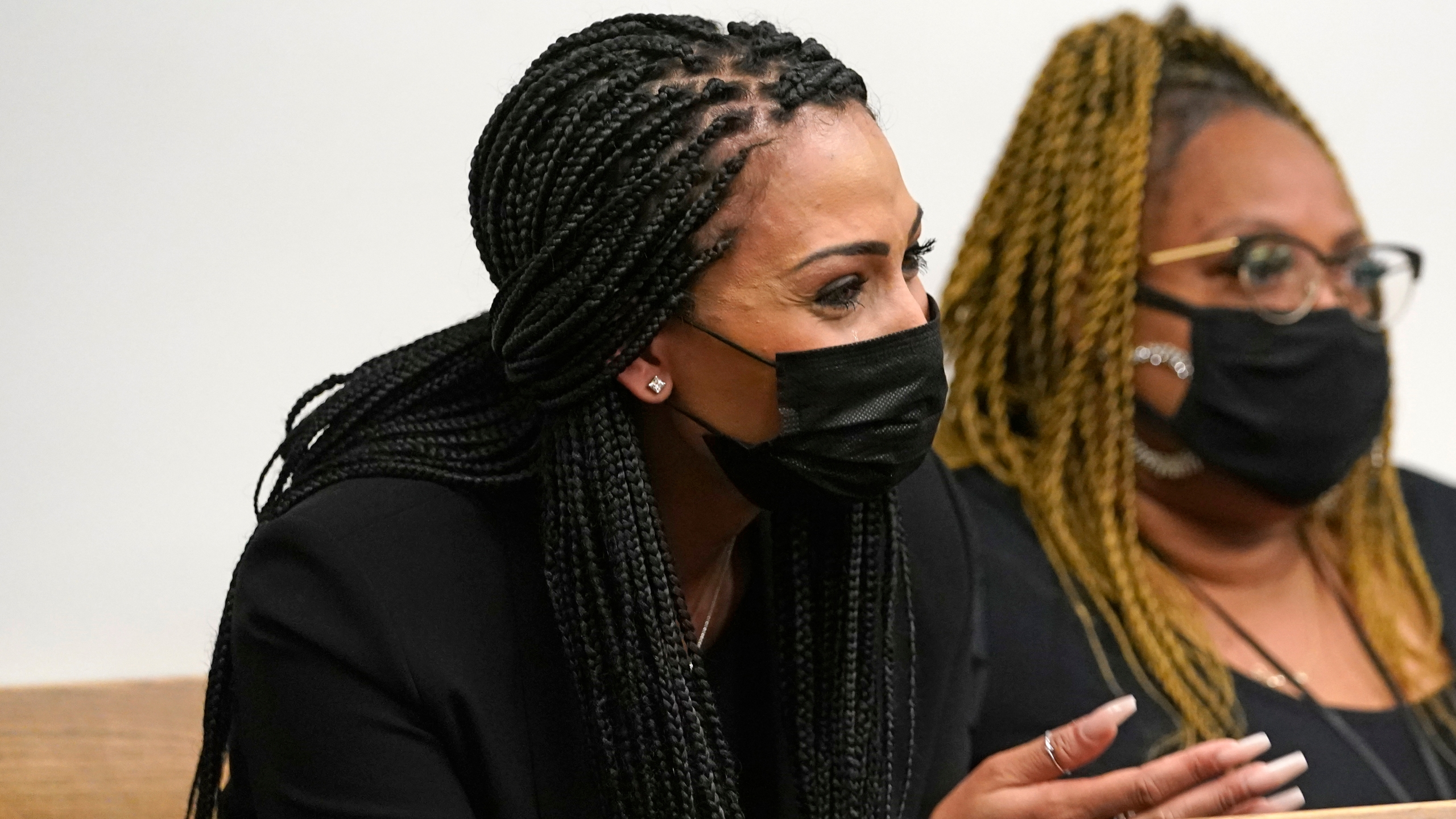 Ashley Sherman, left, wife of NFL player Richard Sherman, spoke in support of her husband at King County District Court, Thursday, July 15, 2021, in Seattle. (AP Photo/Elaine Thompson)