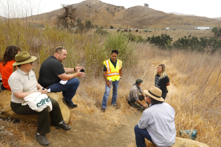 obert Rock, principal architect from Living Habitats, third from left, speaks to the group about plans for the wildlife bridge on June 20, 2021.(Carolyn Cole/Los Angeles Times)