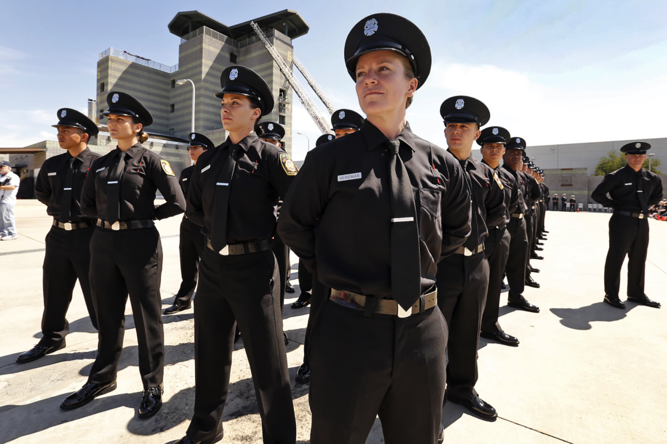 Katie Becker, center, at her April 2016 graduation ceremony from the Los Angeles Fire Department's Valley Recruit Training Academy. Becker has since left the department.(Al Seib / Los Angeles Times)
