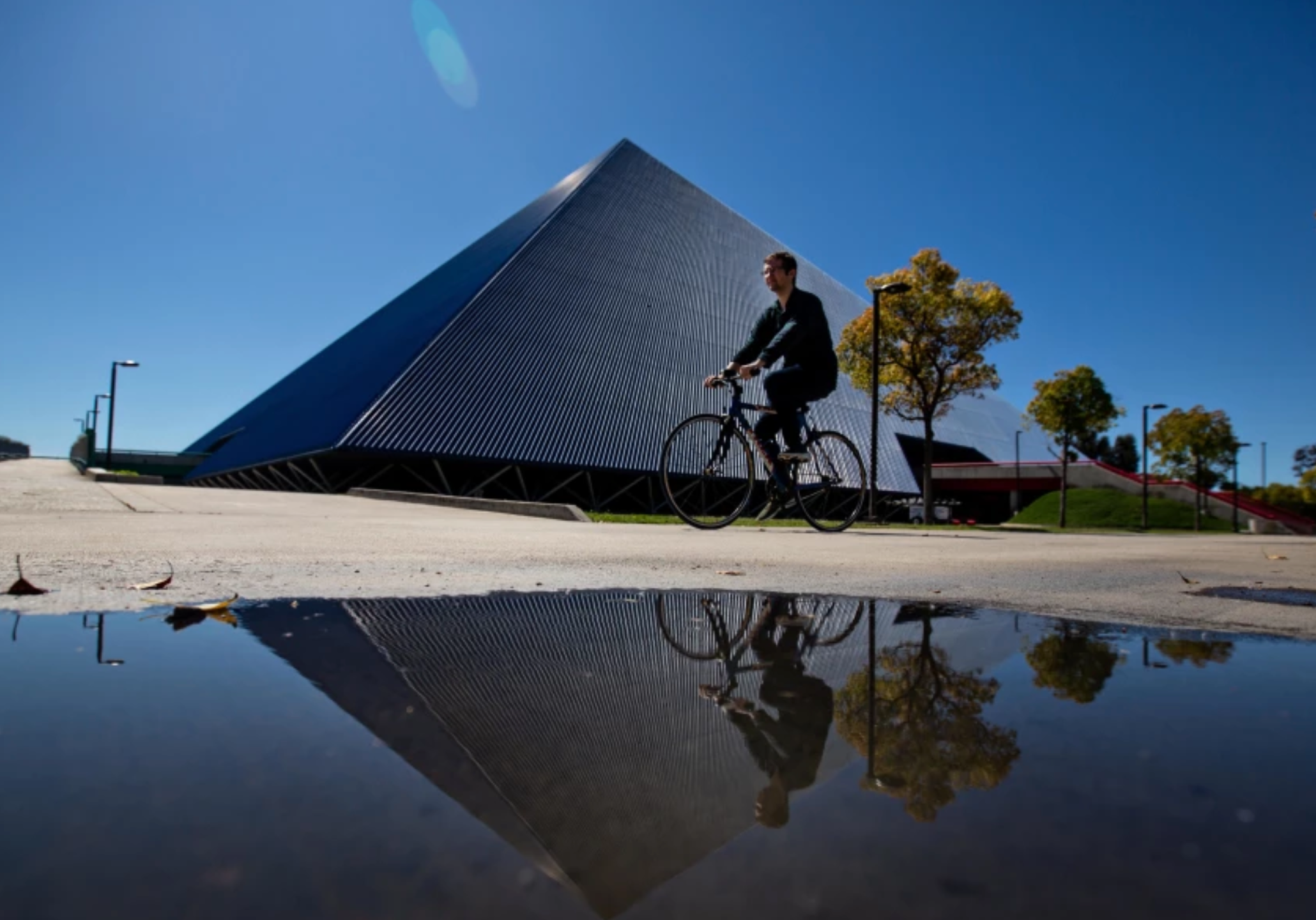 A student bikes pass the Walter Pyramid at Cal State Long Beach.(Jason Armond / Los Angeles Times)