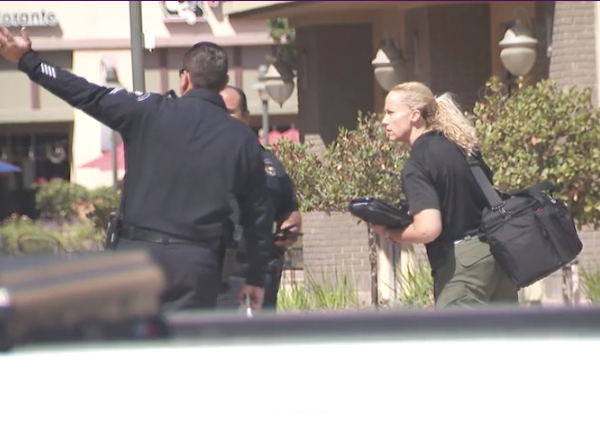 Authorities respond to a double shooting at a Corona movie theater on July 27, 2021. (KTLA)