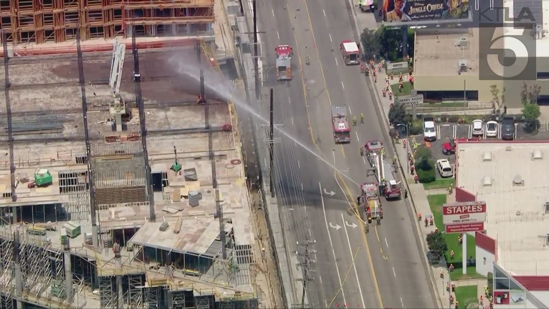 Firefighters extinguish a blaze at a building that was under construction in West L.A. on July 15, 2021. (KTLA)