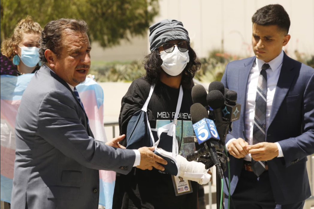 Vishal Singh, center, a documentary filmmaker, alleged he was struck with a baton by a police officer during a protest outside a Westlake spa on July 17, 2021. (Al Seib/Los Angeles Times)