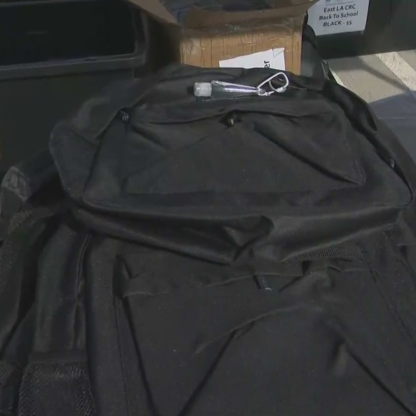 Children can receive school supplies and backpacks for free as part of a series of giveaways, such as one held at East Los Angeles College on July 23, 2021. (KTLA)