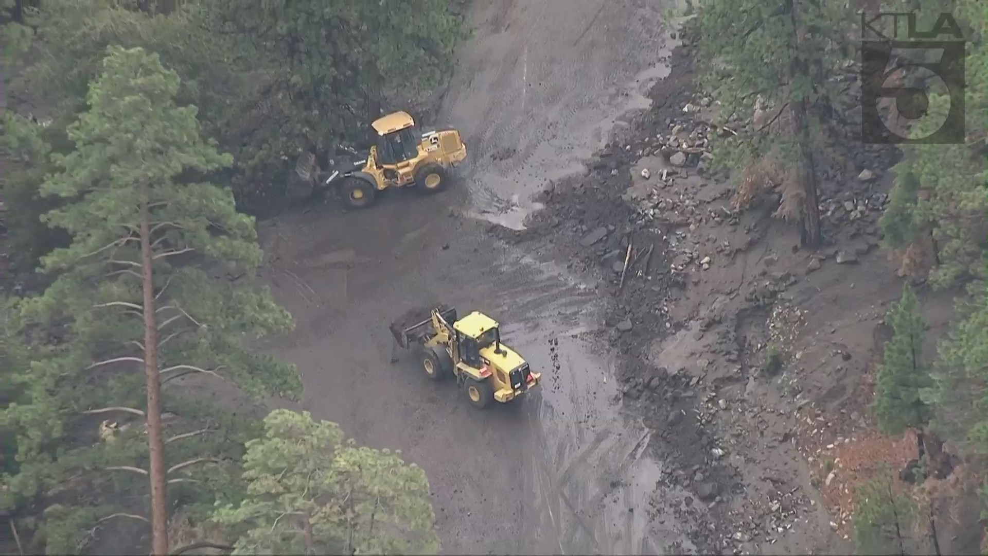 Caltrans crews work to clear mud flow along Highway 38 in Big Bear area on July 30, 2021. (KTLA)