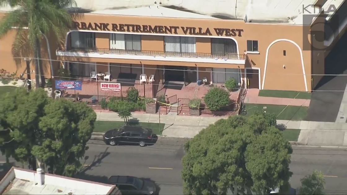 The first floor of a Burbank retirement community is cordoned off with police tape amid a stabbing investigation on July 30, 2021. (KTLA)