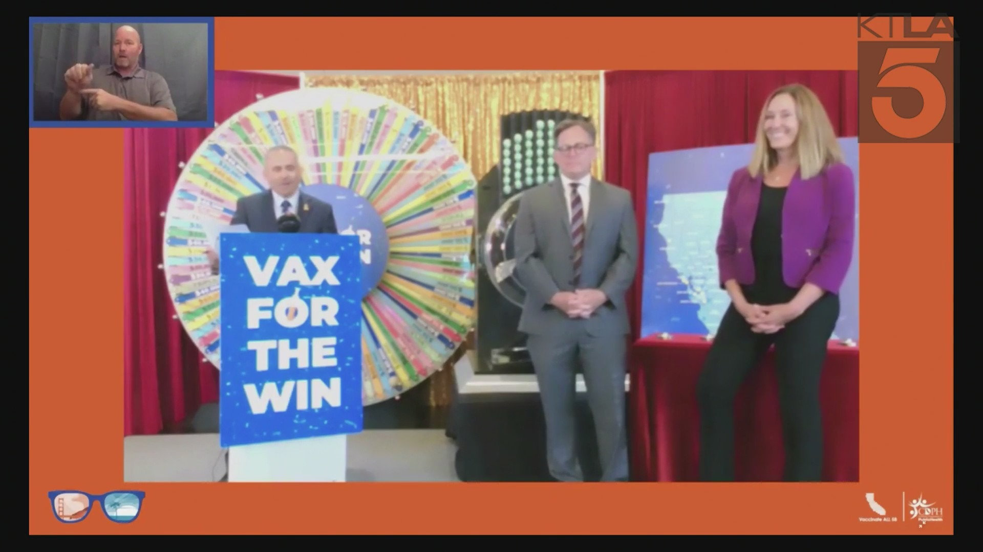 """Dr. Tomás J. Aragón (left), state public health officer and California Department of Public Health director, is joined by Sen. Josh Newman (middle) and Asm. Jacqui Irwin in the drawing of six winners for the """"California Dream Vacations"""" giveaway as part of the state's vaccine incentive program on July 1, 2021."""