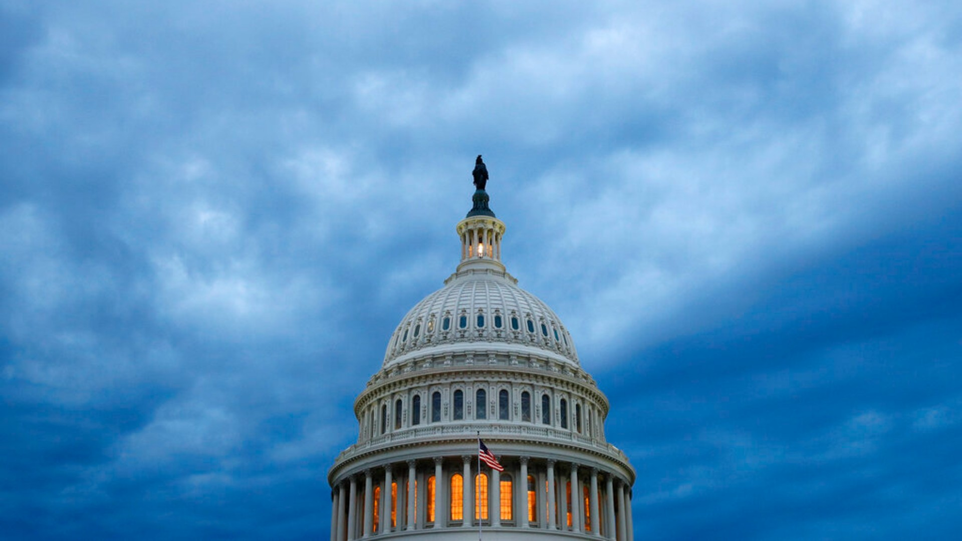 In this June 12, 2019, file photo, clouds roll over the U.S. Capitol dome as dusk approaches in Washington. (AP Photo/Patrick Semansky, File)
