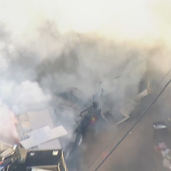 An LAPD tractor-trailer loaded with fireworks exploded in South Los Angeles on June 30, 2021. (KTLA)