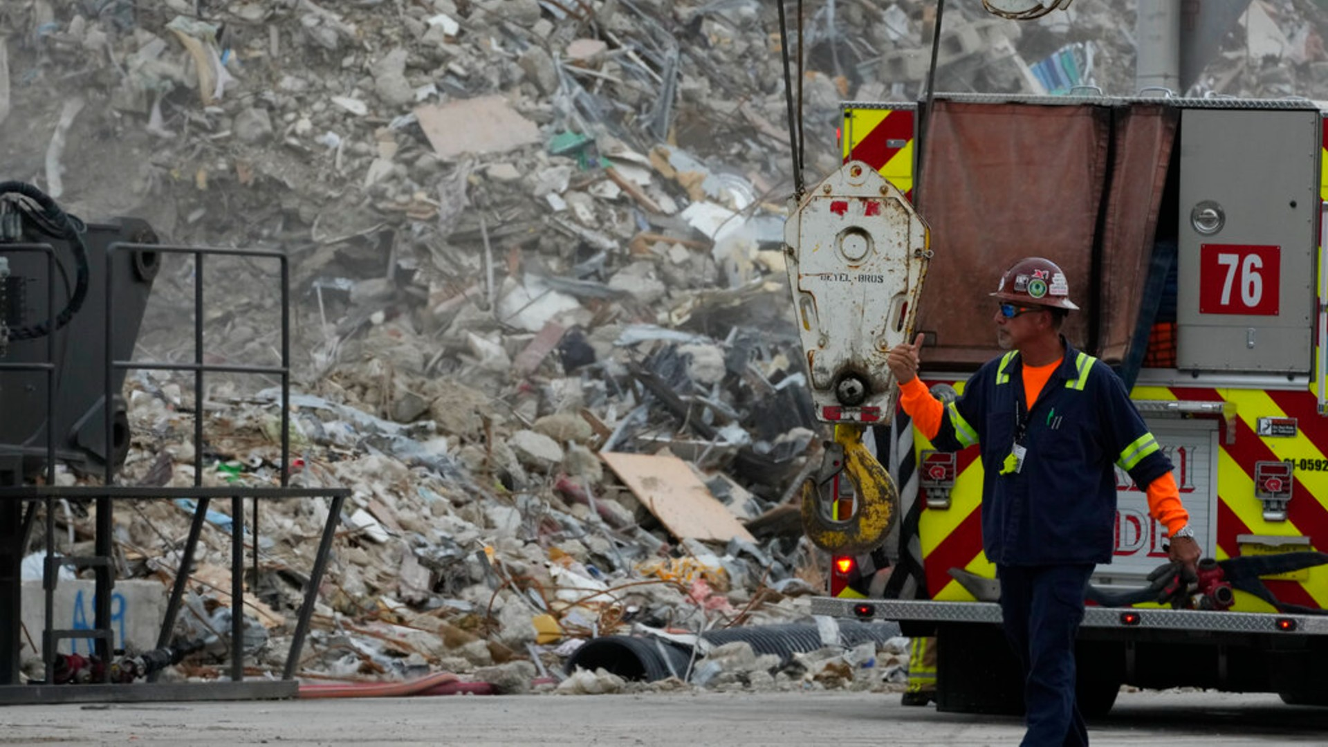 Crews work in the rubble of the demolished section of the Champlain Towers South building, as removal and recovery work continues at the site of the partially collapsed condo building, on Monday, July 12, 2021, in Surfside, Fla.(AP Photo/Rebecca Blackwell)