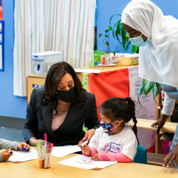 In this June 11, 2021, file photo, Vice President Kamala Harris talks with bilingual early childhood education school CentroNia students Jayden Bello, left, and Celina Barrera during a visit to the school in northwest Washington. (AP Photo/Manuel Balce Ceneta, File)