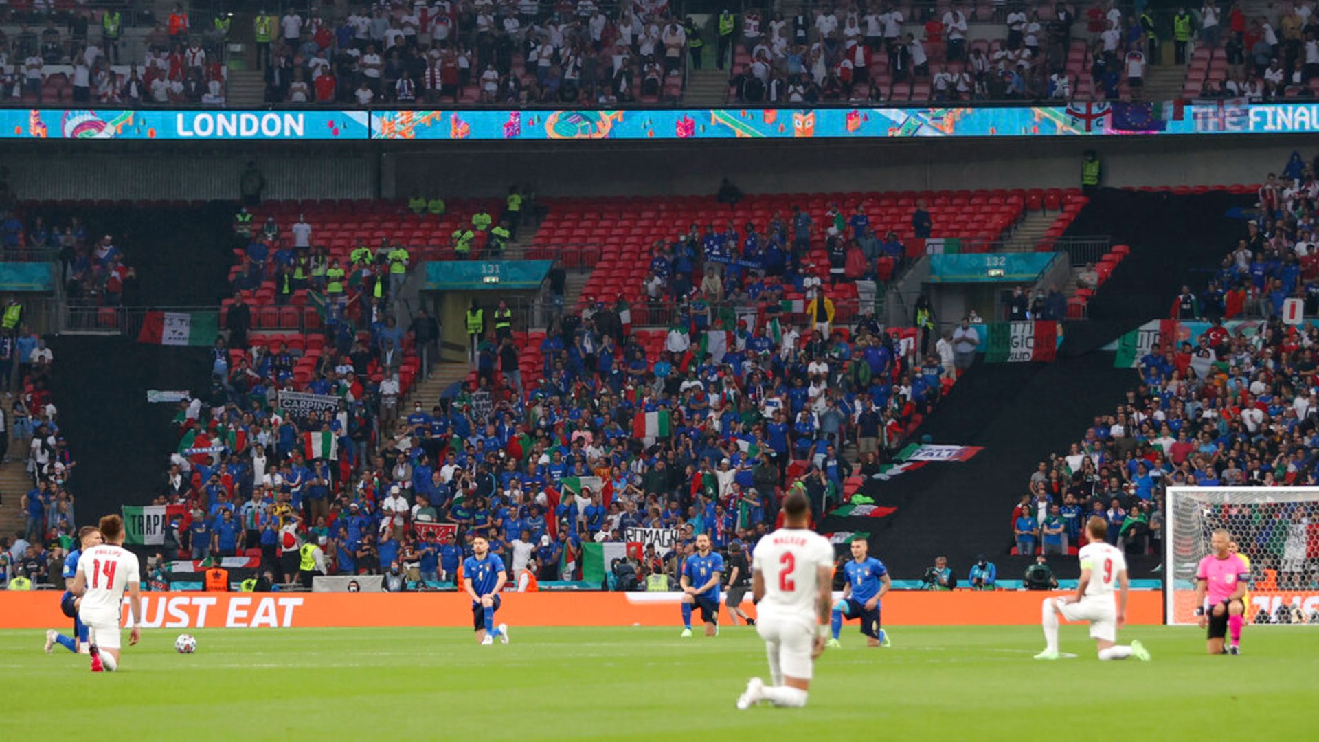 The players take a knee before the Euro 2020 soccer championship final match between England and Italy at Wembley stadium in London, Sunday, July 11, 2021. (Carl Recine/Pool Photo via AP)