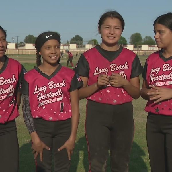 Players with the Long Beach Heartwell 12-U Silver All-Star fast-pitch softball team pose for a pic on July 16, 2021.