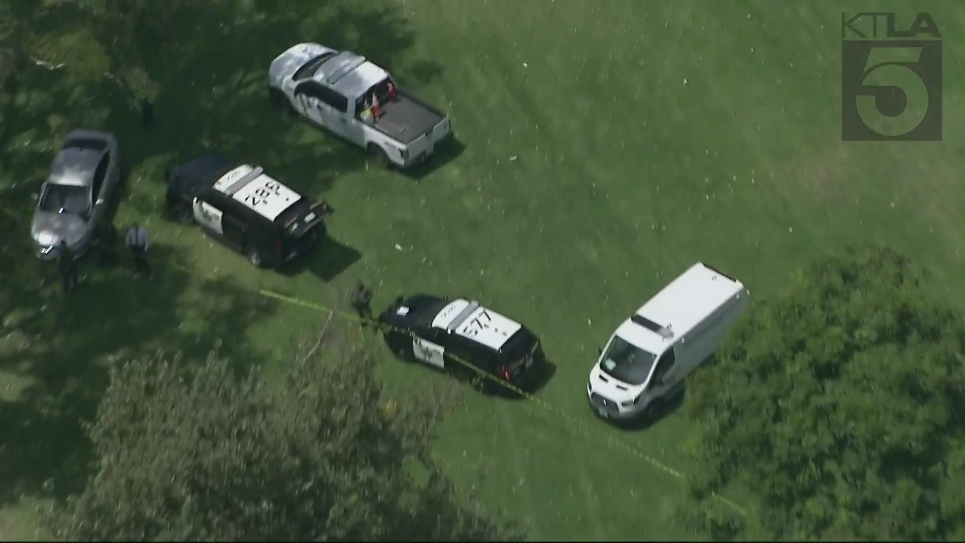 Authorities responded to Mile Square Regional Park in Fountain Valley, where a body was found in one of the lakes on July 23, 2021. (KTLA)