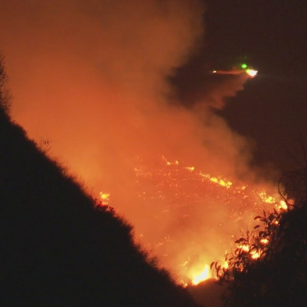 A helicopter helps fight the Tuna Fire that sparked in Malibu on July 9, 2021. (RMG News)