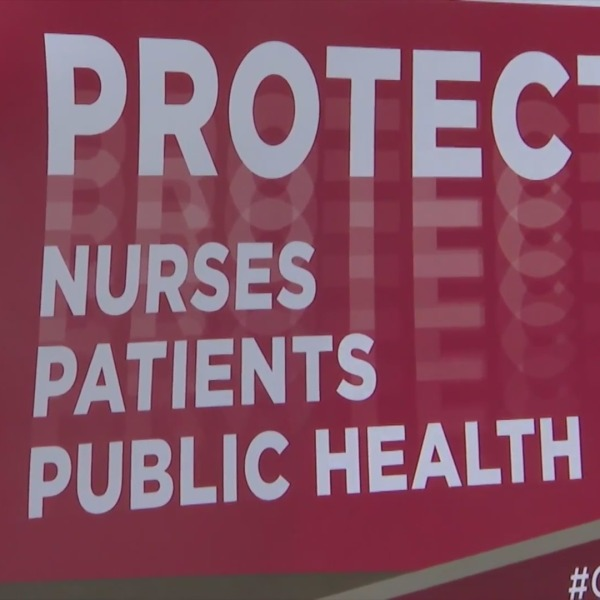A sign is seen during a nurses protest in this file photo. (KTLA)