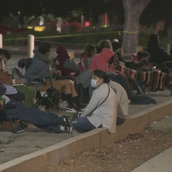 People wait outside the Federal Building in West Los Angeles to renew their passports on July 23, 2021. (KTLA)