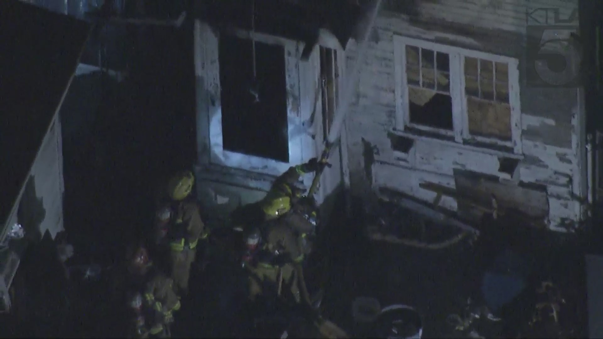 Crews put out a fire at an East Hollywood home on July 26, 2021. (KTLA)