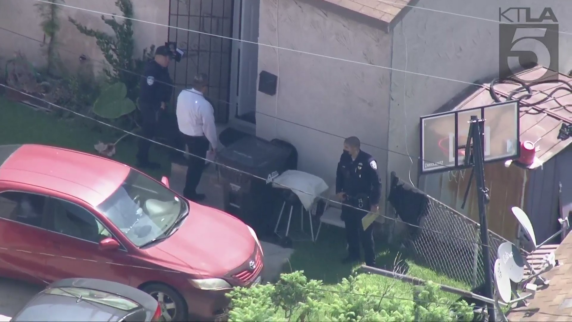 Authorities investigate after a woman was found dead in Bell Gardens on July 28, 2021. (KTLA)