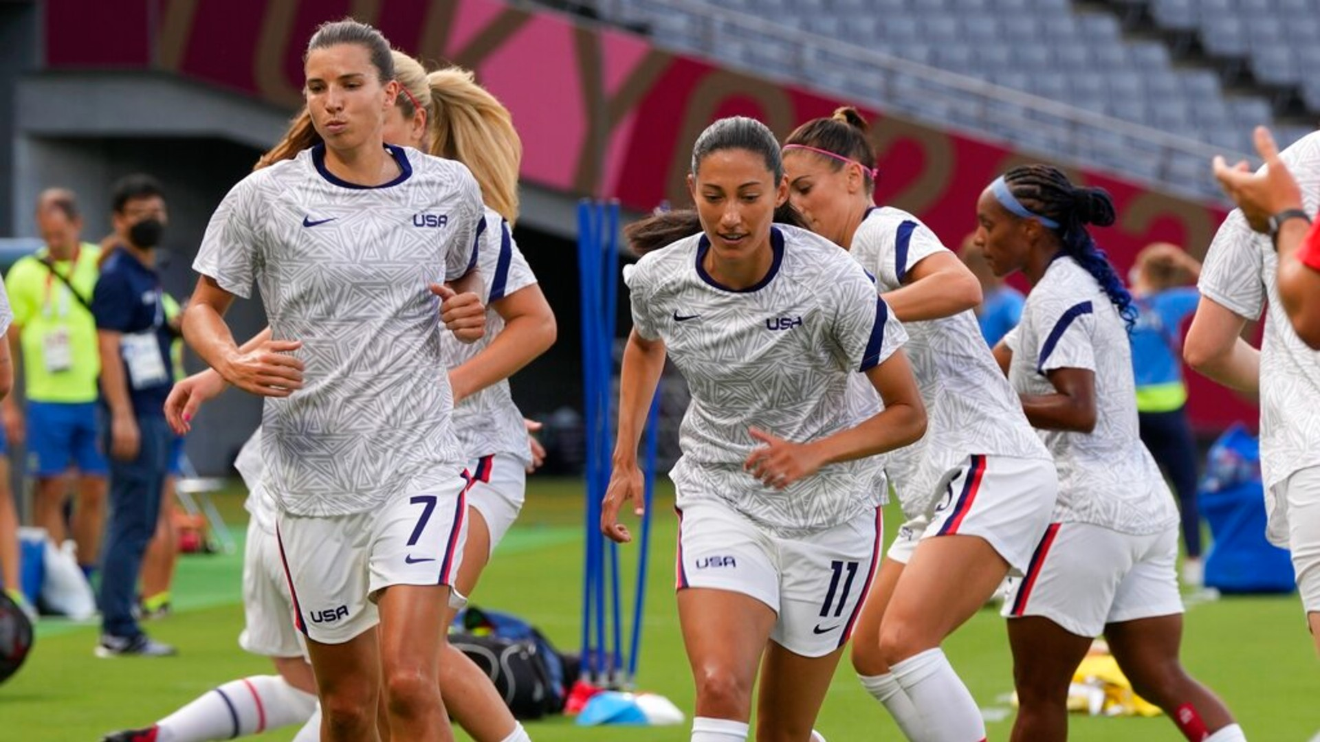United States players warm up before a women's soccer match against Sweden at the 2020 Summer Olympics, Wednesday, July 21, 2021, in Tokyo. (AP Photo/Ricardo Mazalan)