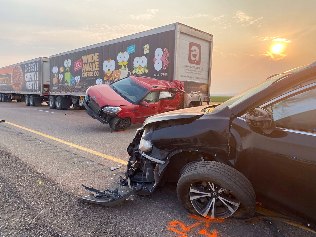 This photo provided by the Utah Highway Patrol shows several of the vehicles involved in a fatal pileup, Sunday, July 25, 2021, on Interstate 15 in Millard County, near the town of Kanosh, Utah. (Utah Highway Patrol via AP)