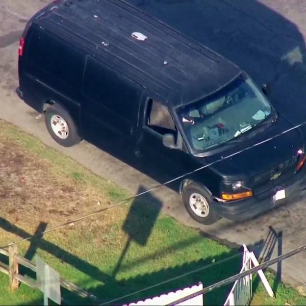 Deputies investigate a van in the Pico Rivera area on July 20, 2021. (KTLA)