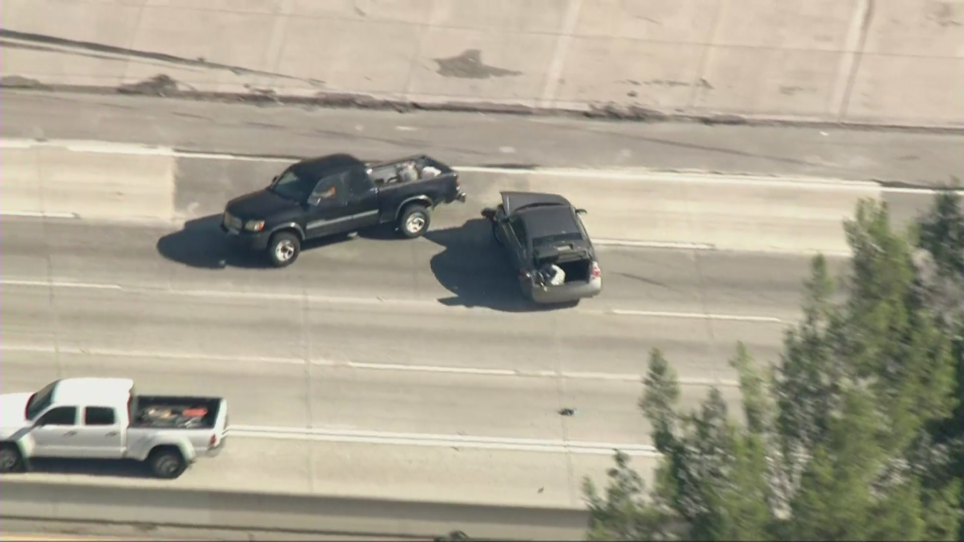 The driver in a pursuit across the San Gabriel Valley crashed into two trucks along the 210 Freeway on Aug. 2, 2021. (KTLA)
