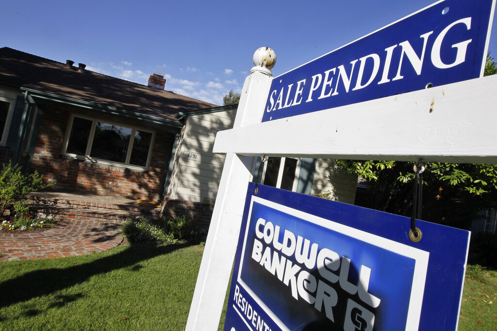 Southern California's median home price set another record in July, but the rate of increase slowed. (AP Photo/Paul Sakuma, File)