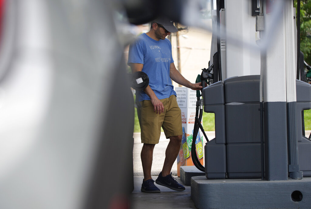 A motorist prepares to fill up the gasoline tank on his vehicle at a Shell station Thursday, July 22, 2021, in southeast Denver. (AP Photo/David Zalubowski)