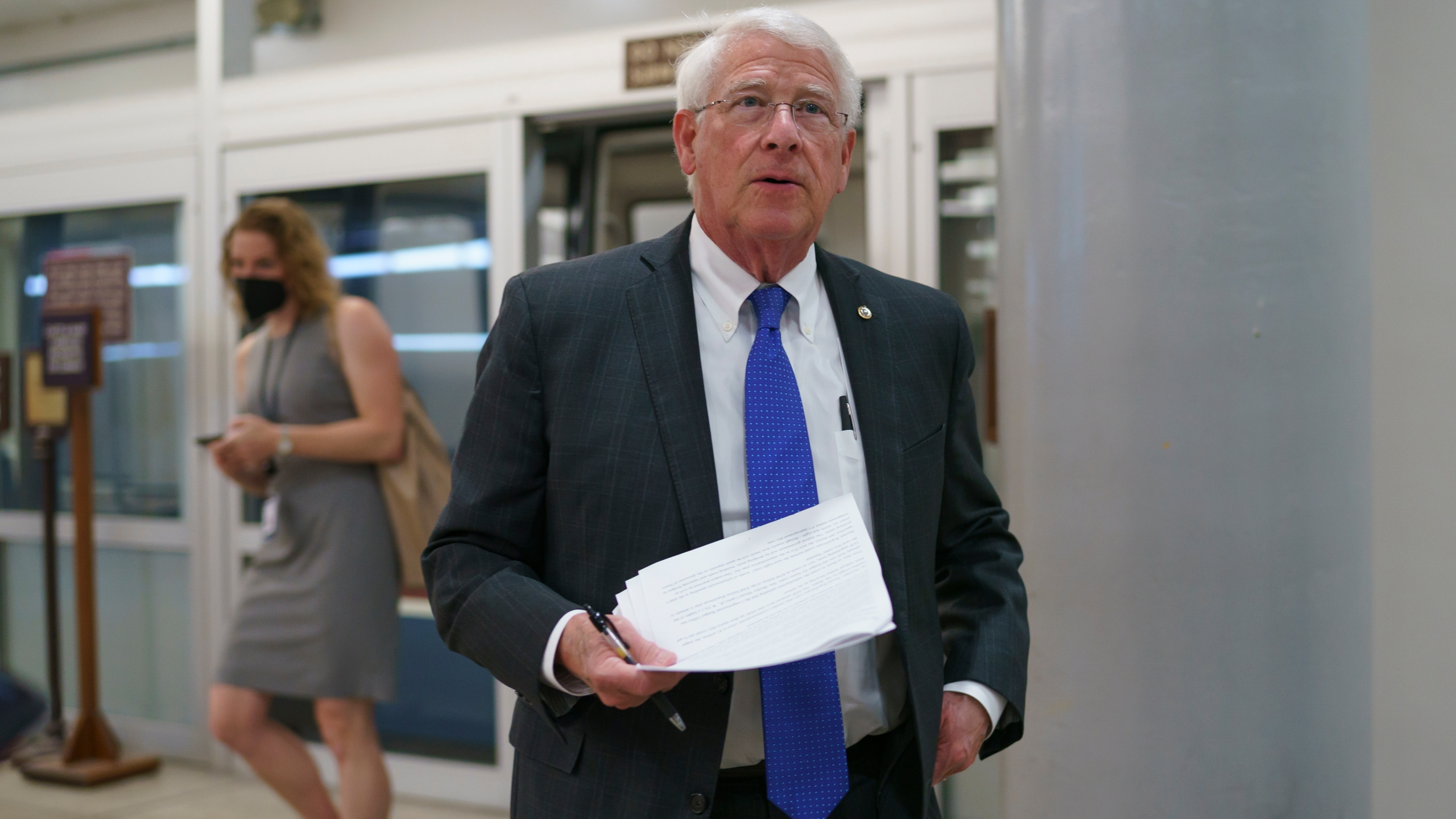 In this Thursday, May 27, 2021 file photo, Sen. Roger Wicker, R-Miss., arrives as senators go to the chamber for votes ahead of the approaching Memorial Day recess, at the Capitol in Washington. Republican Sen. Roger Wicker of Mississippi says installing massive pumps to drain water from the south Mississippi Delta would be a way to fight environmental injustice. He says the project would help low-income and minority residents whose lives are disrupted by flooding. Wicker made his statements to a Senate subcommittee Thursday, July 22, 2021. (AP Photo/J. Scott Applewhite, File)