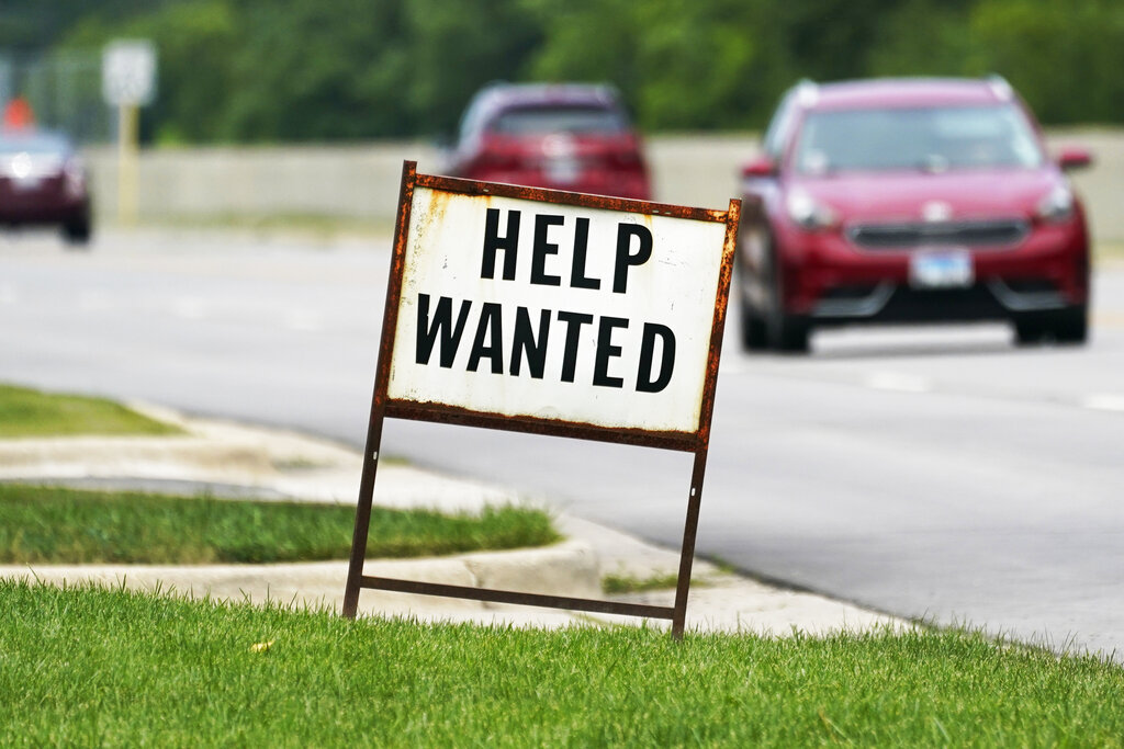 A help wanted sign is displayed at a gas station in Mount Prospect, Ill., Tuesday, July 27, 2021. (AP Photo/Nam Y. Huh)
