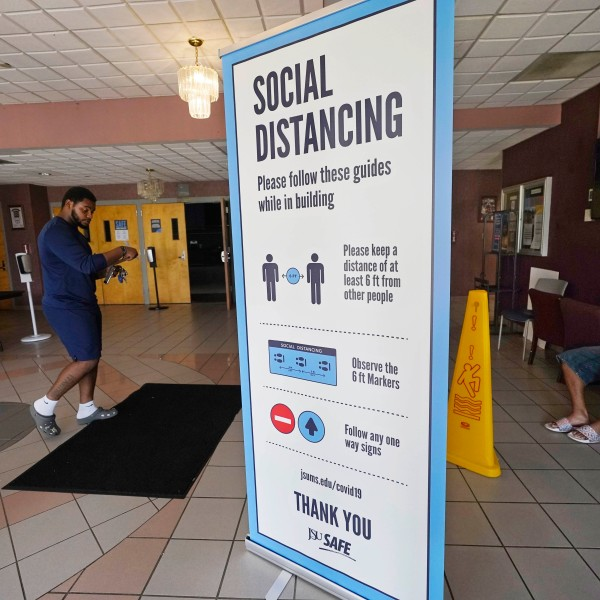 In this July 27, 2021 file photo, social distancing as well as face covering is recommended at the COVID-19 vaccination site in the Rose E. McCoy Auditorium on the Jackson State University campus in Jackson, Miss. (AP Photo/Rogelio V. Solis, File)
