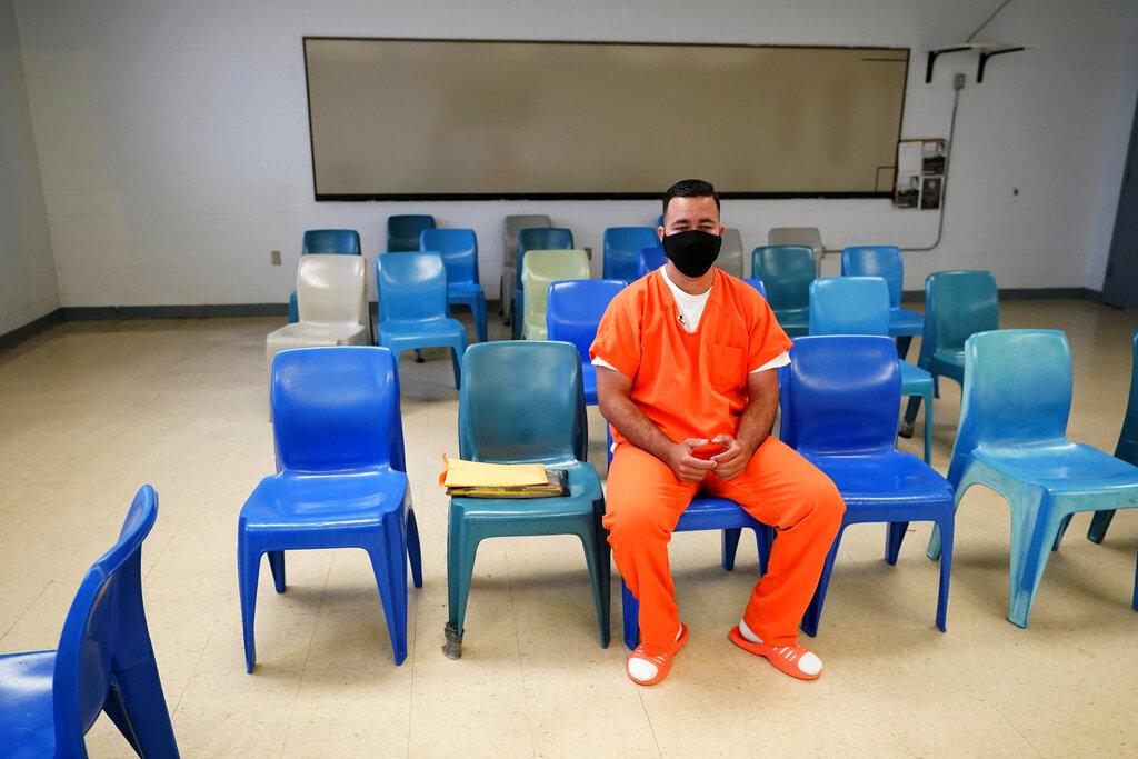 Immigration detainee Alexander Martinez speaks during an interview with The Associated Press inside the Winn Correctional Center in Winnfield, La., Friday, July 30, 2021. (AP Photo/Gerald Herbert)
