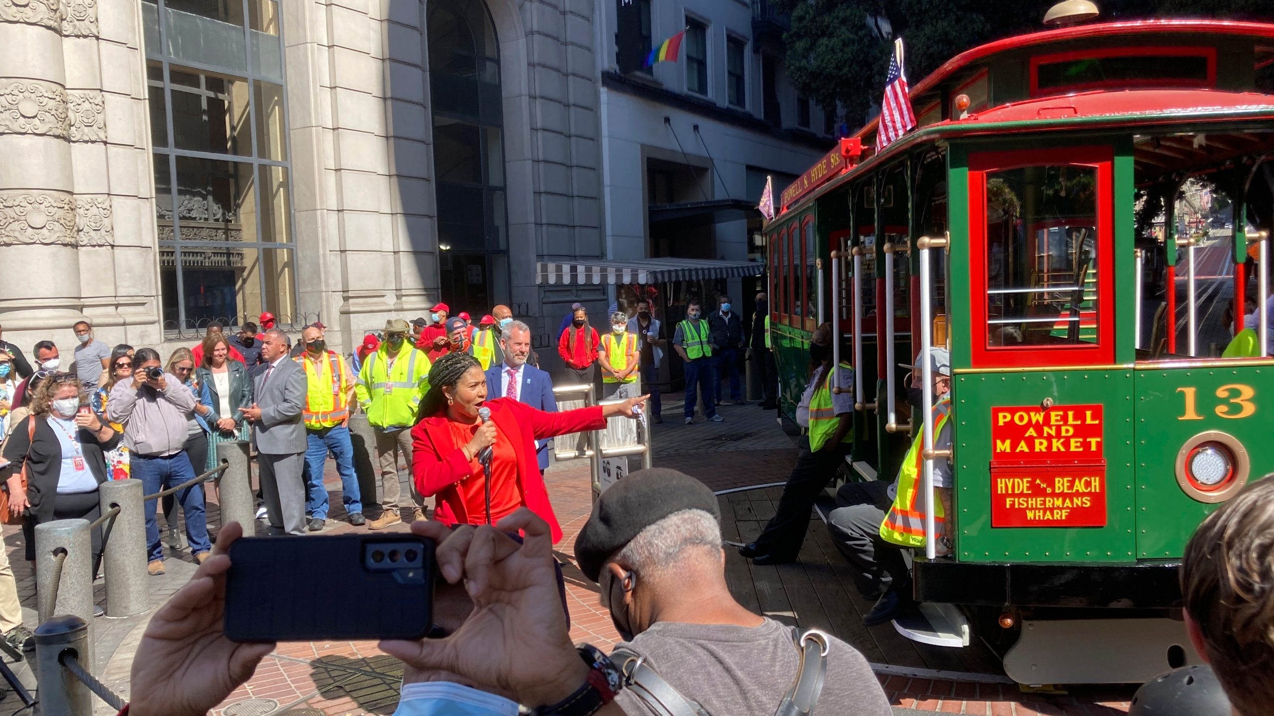 Mayor London Breed welcomes people to return of the cable car service during a ceremony at the Powell Street turnaround plaza in San Francisco on Aug. 2, 2021. San Francisco's iconic cable cars are rolling again after being sidelined by the pandemic for months. People were already forming long lines to ride the cable cars, which will offer free rides the month of August. (AP Photo/Olga Rodriguez)