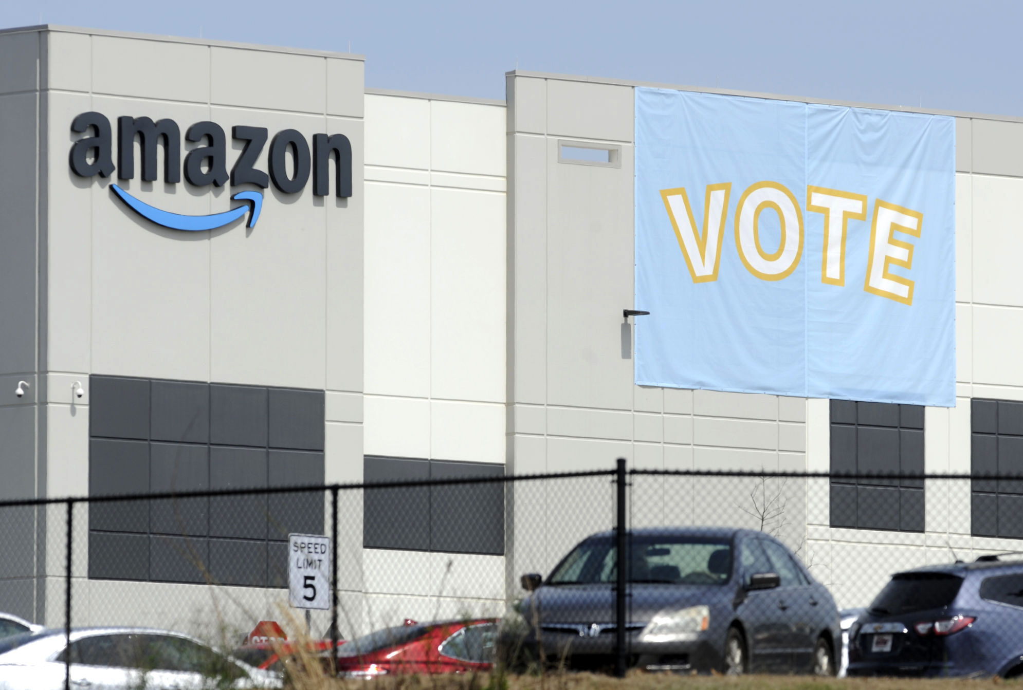In this March 30, 2021 file photo, a banner encouraging workers to vote in labor balloting is shown at an Amazon warehouse in Bessemer, Ala. (AP Photo/Jay Reeves, File)