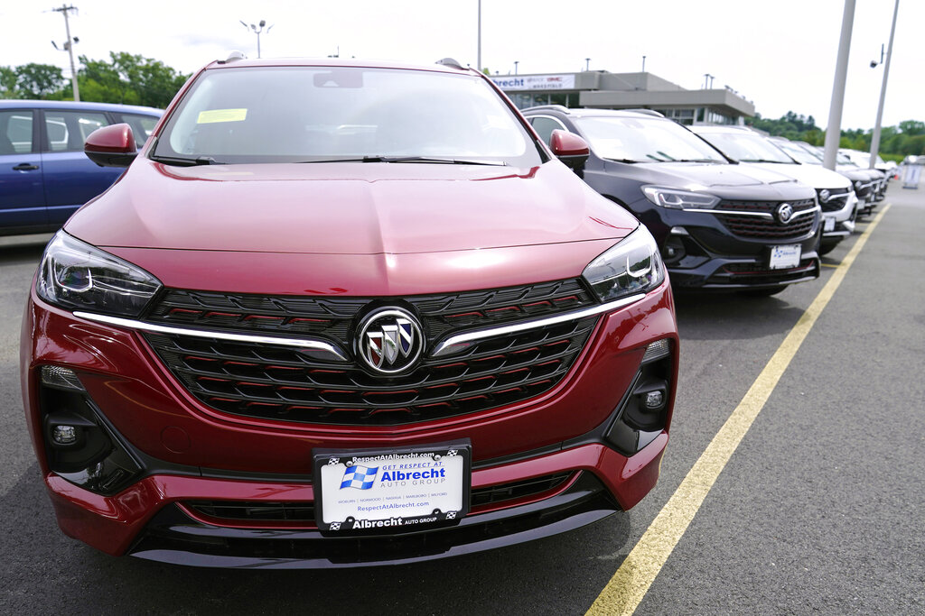New Buick Encore SUV's displayed on the sales lot at the Albrecht Auto Group dealership, Tuesday, Aug. 3, 2021, in Wakefield, Mass. (AP Photo/Charles Krupa)