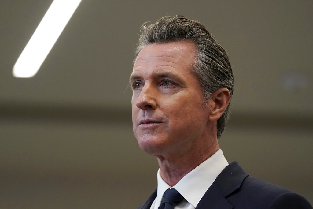 In the July 26, 2021 file photo Gov. Gavin Newsom speaks at a news conference in Oakland, California. (AP Photo/Jeff Chiu, File)