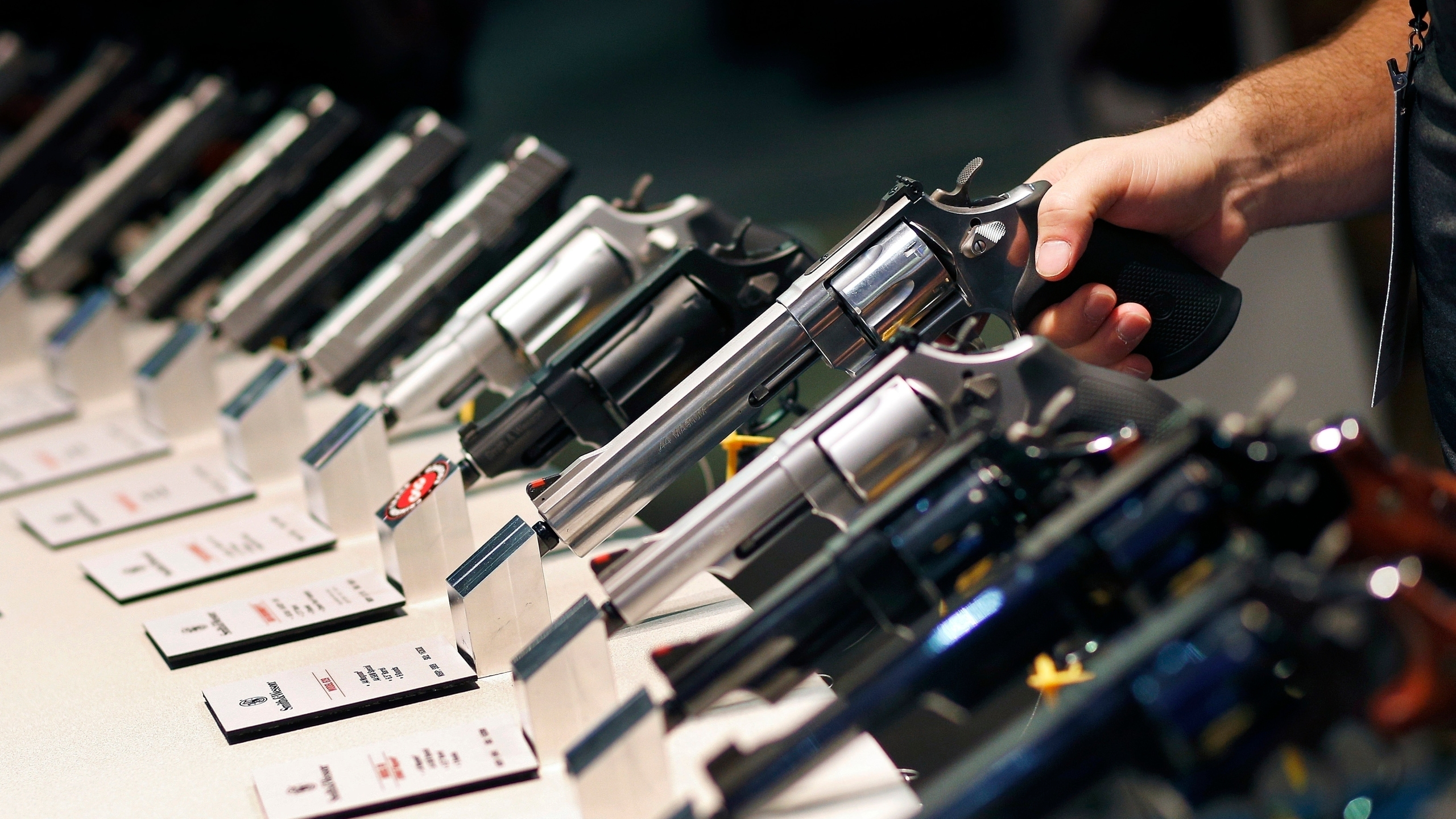 Handguns are displayed at the Smith & Wesson booth at the Shooting, Hunting and Outdoor Trade Show in Las Vegas on Jan. 19. 2016. (John Locher / Associated Press)