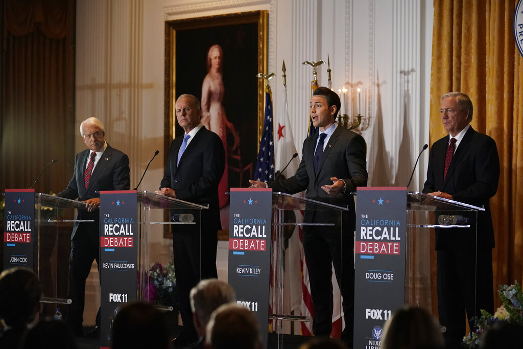 From left, Republican candidates for California Governor John Cox, Kevin Faulconer, Kevin Kiley and Doug Ose participate in a debate at the Richard Nixon Presidential Library Wednesday, Aug. 4, 2021, in Yorba Linda, Calif. (AP Photo/Marcio Jose Sanchez)