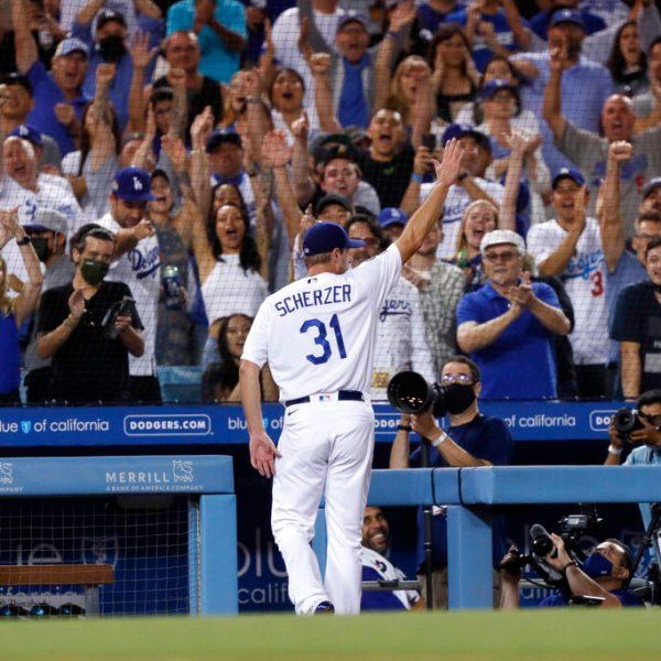 Los Angeles Dodgers starting pitcher Max Scherzer takes a curtain call during the seventh inning of a baseball game against the Houston Astros in Los Angeles, Wednesday, Aug. 4, 2021. (AP Photo/Alex Gallardo)
