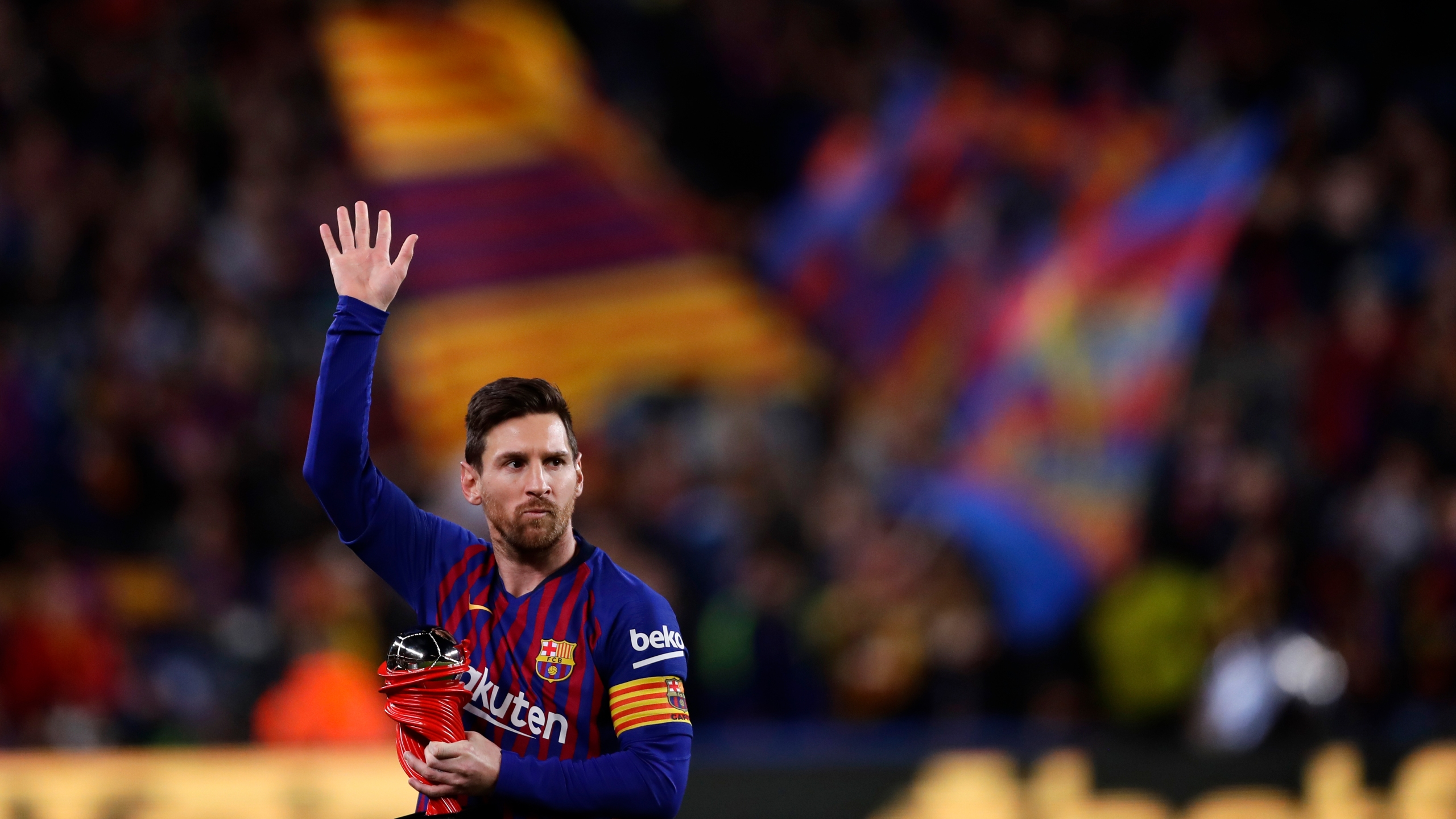 In this April 6, 2019, file photo, Barcelona forward Lionel Messi waves at the crowd as he holds the trophy of the best Spanish La Liga player prior to a soccer match between FC Barcelona and Atletico Madrid at the Camp Nou stadium in Barcelona, Spain. (AP Photo/Manu Fernandez, File)