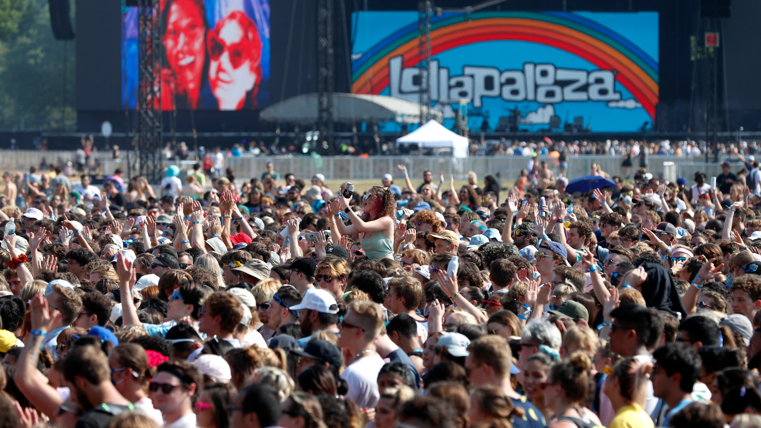 In this July 29, 2021 file photo, fans gather and cheer on day one of the Lollapalooza music festival at Grant Park in Chicago. Chicago health officials on Thursday, Aug. 12, 2021, reported 203 cases of COVID-19 connected to Lollapalooza, casting it as a number that was anticipated and not yet linked to any hospitalizations or deaths. (AP Photo/Shafkat Anowar File)