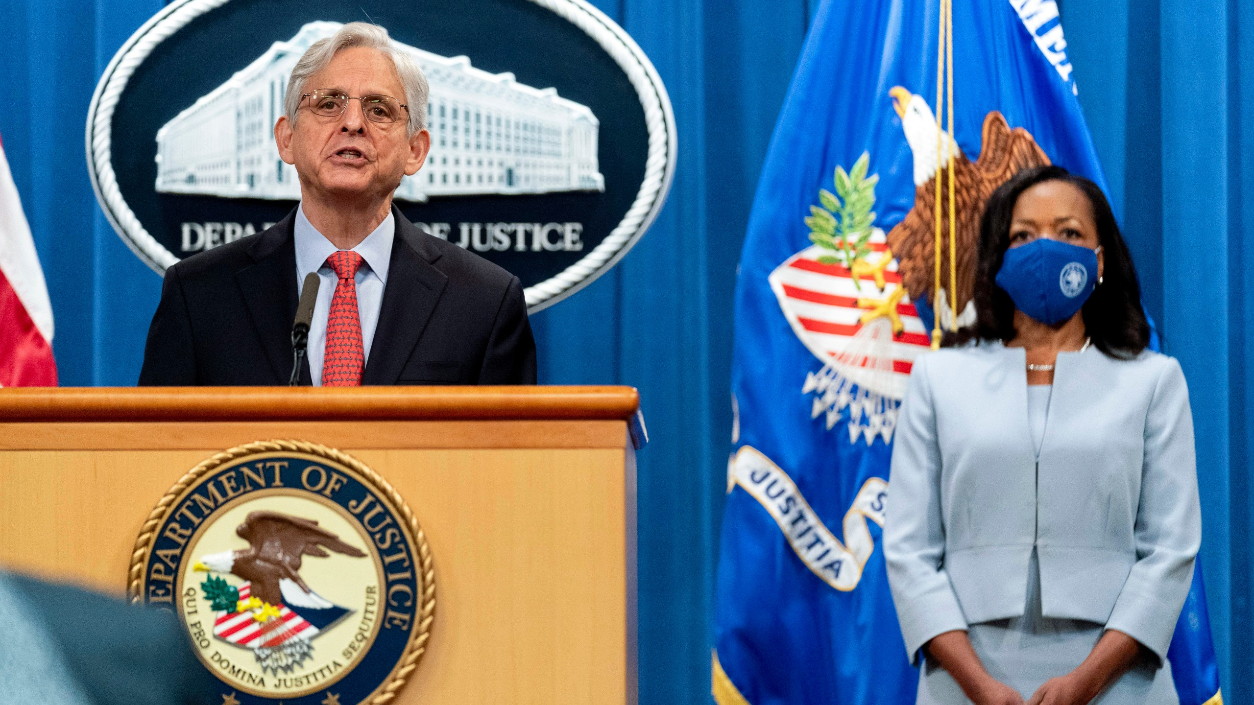 Attorney General Merrick Garland, accompanied by Assistant Attorney General for Civil Rights Kristen Clarke, right, speaks at a news conference at the Department of Justice in Washington on Aug. 5, 2021, to announce that the Department of Justice is opening an investigation into the city of Phoenix and the Phoenix Police Department. (AP Photo/Andrew Harnik)
