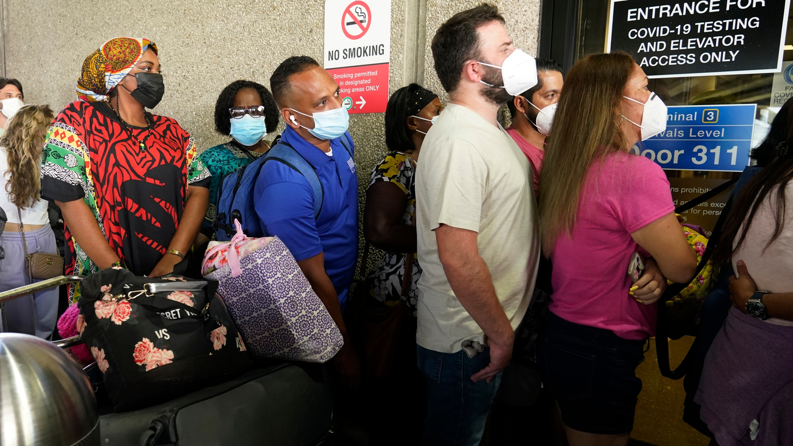 Passengers wait in a long line to get a COVID-19 test to travel overseas at Fort Lauderdale-Hollywood International Airport, Friday, Aug. 6, 2021, in Fort Lauderdale, Fla. (AP Photo/Marta Lavandier)
