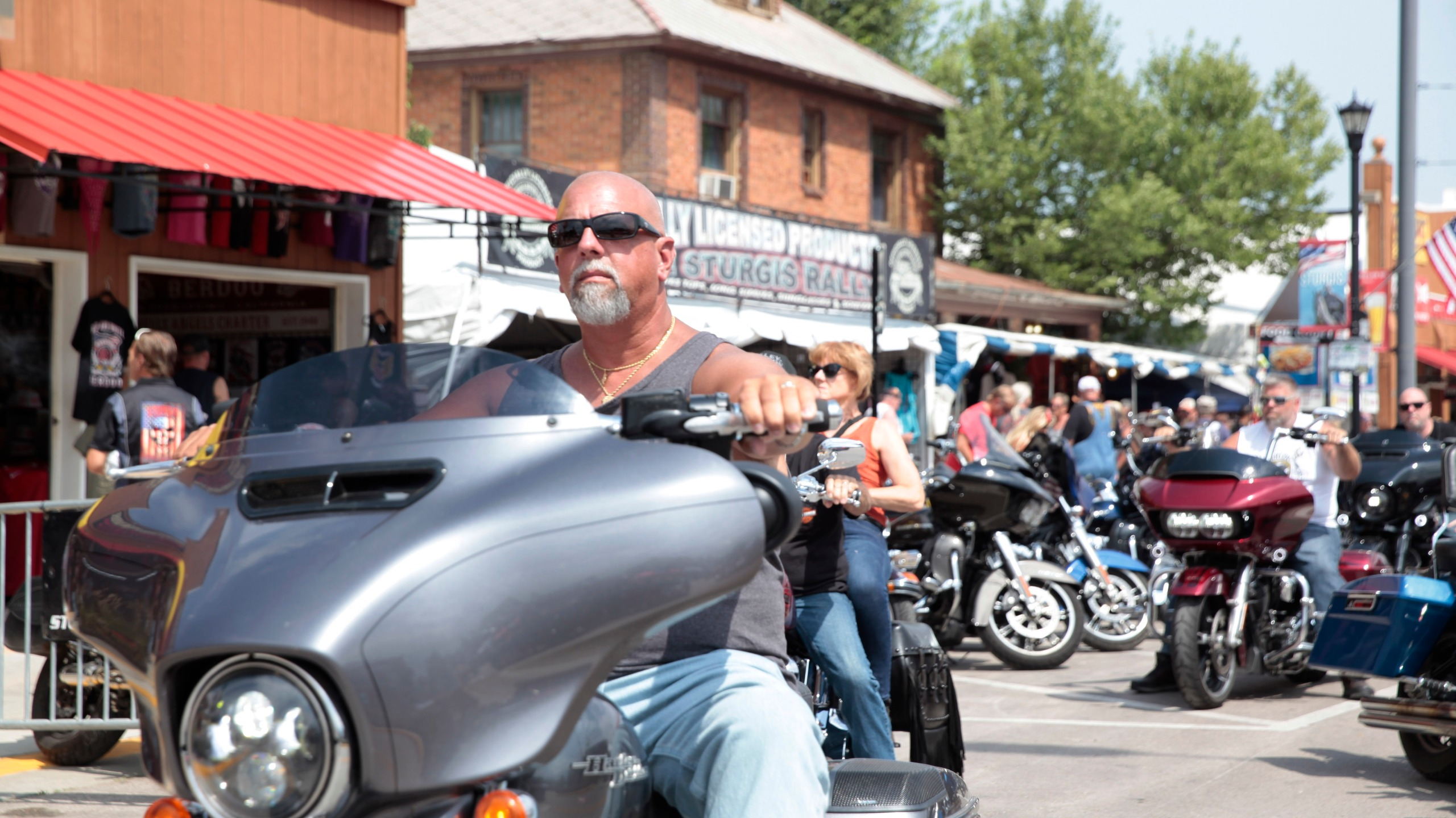 Motorcycles fill the streets of Sturgis, S.D on Friday, Aug. 6, 2021 as the Sturgis Motorcycle Rally began. The annual rally returns just as coronavirus cases in the state are rising with the more contagious delta variant. (AP Photo/Stephen Groves)