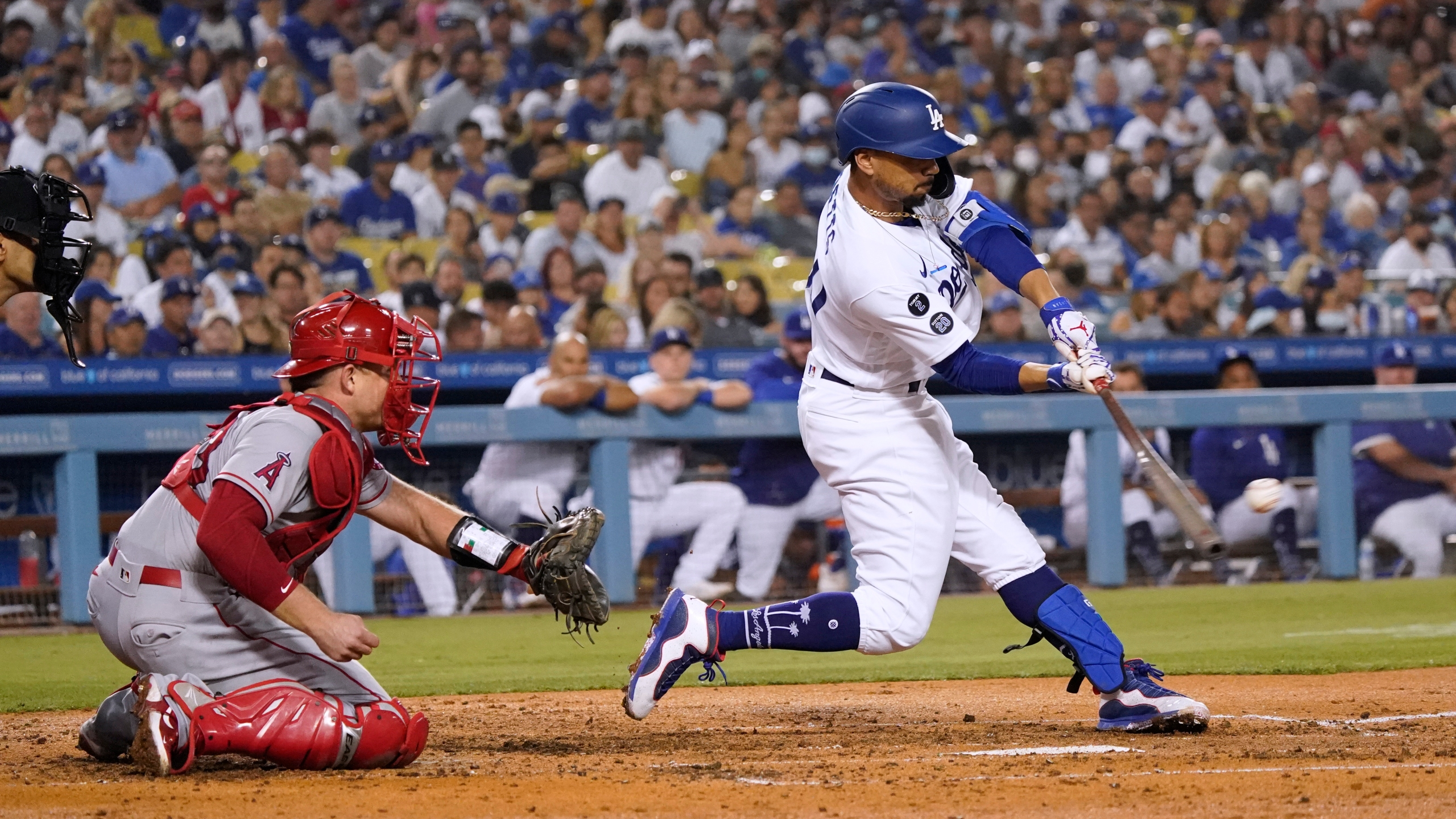 Los Angeles Dodgers' Mookie Betts drives in a run with a single during the fourth inning of the team's baseball game against the Los Angeles Angels on Aug. 6, 2021, in Los Angeles. Betts was taken out of the game with a sore him and was later placed on the injured list. (Marcio Jose Sanchez/Associated Press)