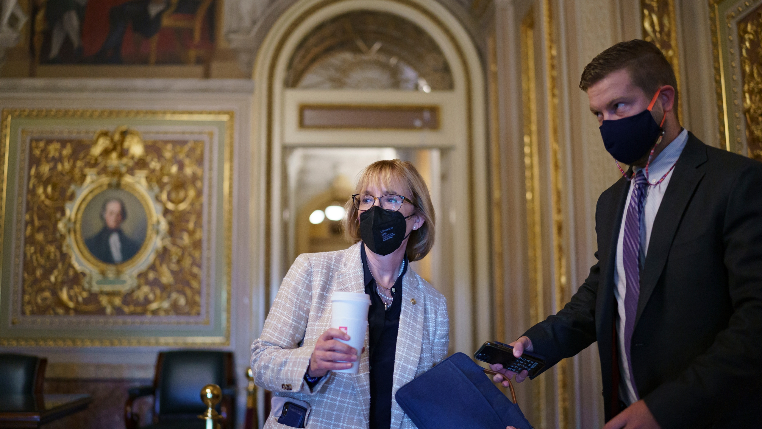 Sen. Maggie Hassan, D-N.H., arrives at the Capitol as the Senate convenes for a rare weekend session on the $1 trillion bipartisan infrastructure bill, at the Capitol in Washington, Saturday, Aug. 7, 2021. (AP Photo/J. Scott Applewhite)