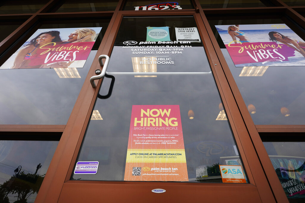 A Now Hiring sign at a business in Richmond, Va., Wednesday, June 2, 2021. (AP Photo/Steve Helber)
