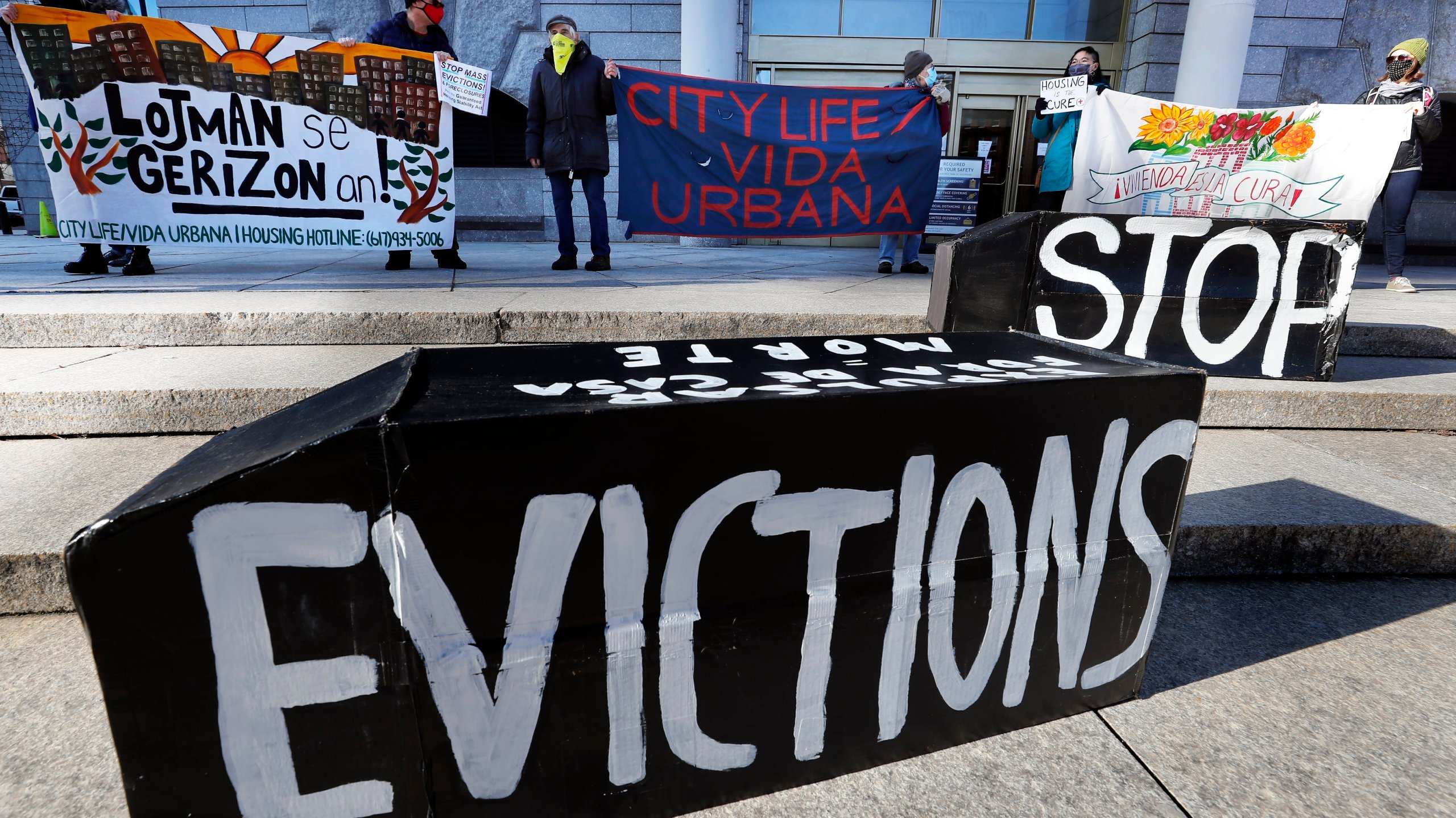 """In this Jan. 13, 2021, file photo, tenants' rights advocates demonstrate in front of the Edward W. Brooke Courthouse in Boston. A federal judge is refusing landlords' request to put the Biden administration's new eviction moratorium on hold, though she made clear she thinks it's illegal. U.S. District Judge Dabney Friedrich on Friday, Aug. 13, said her """"hands are tied"""" by an appellate ruling the last time courts considered the evictions moratorium in the spring. (AP Photo/Michael Dwyer, File)"""